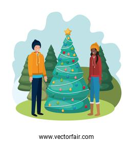 couple with christmas tree in landscape