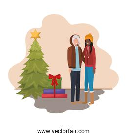 couple with christmas tree and gifts