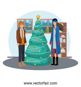 couple with christmas tree in livingroom