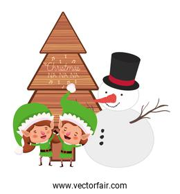 couple of elves with snowman and christmas tree