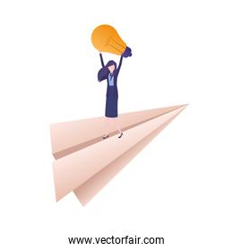 businesswoman on paper plane and light bulb