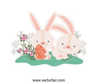 easter rabbits with egg and flowers