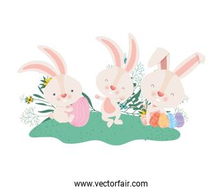 easter rabbits with eggs and flowers icon