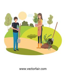couple with trees to plant in landscape