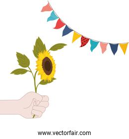 hand with sunflower isolated icon