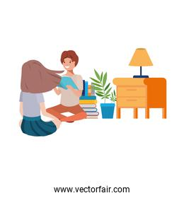 couple sitting with stack of books