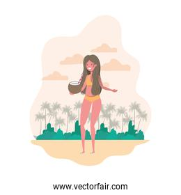 woman with swimsuit and coconut water in hand