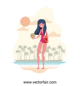 woman with swimsuit and sand bucket
