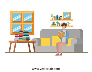 man with book in hands in living room