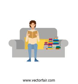 man sitting on chair with book in hands