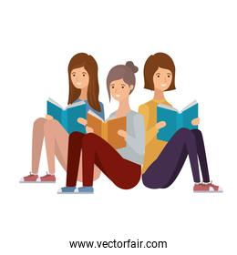 women sitting with book in hands