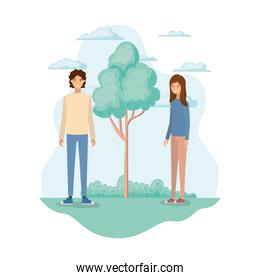 young couple in landscape with trees and plants
