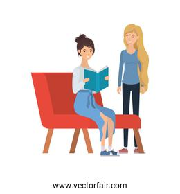 women sitting on chair with book in hands