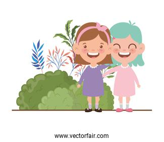 baby girls standing smiling in landscape