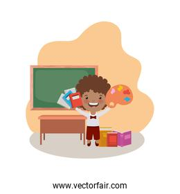 student boy with school supplies in the classroom