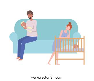 young couple sitting on sofa with newborn baby