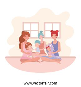 cute pregnancy mothers seated lifting babies in the room