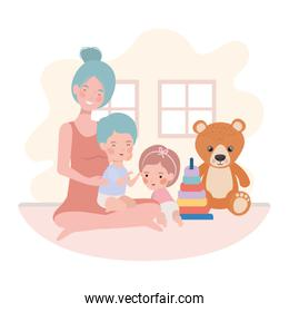 cute pregnancy mother with little kids in the room
