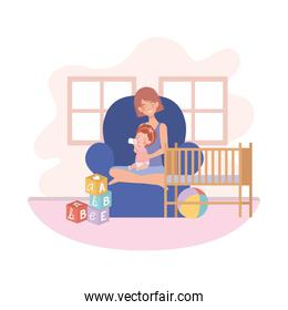 cute pregnancy mother with little girl seated in sofa