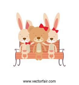 cute animals sitting in the park chair