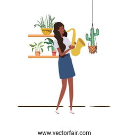 woman with saxophone and houseplants on macrame hangers of background