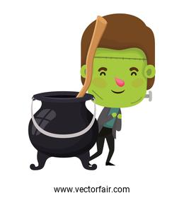 cute little boy with frankenstein costume and cauldron