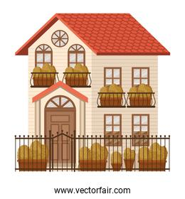 beauty house with autumn plants and fence facade