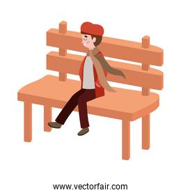 cute little boy with autumn clothes seated in park chair