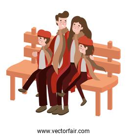 parents and kids with autumn clothes in wooden chair