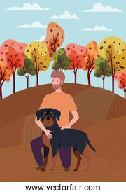 young man with cute dog mascot in the autumn camp