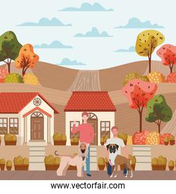 young men with cute dogs mascots in the autumn city scene