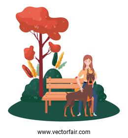 young woman with cute dog in the park