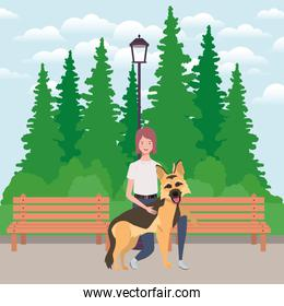 young woman with cute dog mascot in the park