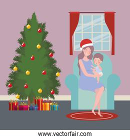 mother and baby with pine tree christmas celebration