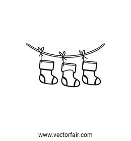 figure christmas boots hanging on a rope