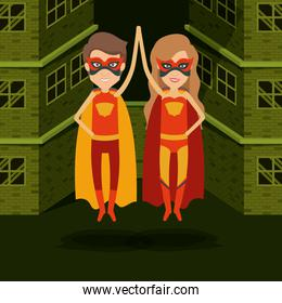 green color background buildings brick facade with colorful superhero couple with clashing hands