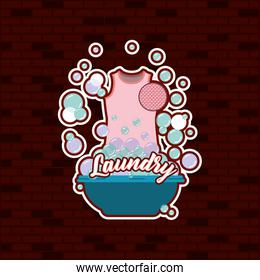 brick wall background of pink blouse female cloth in basin with soap laundry text