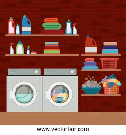 brick wall background of clothes with wash machines and elements of home laundry