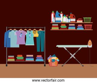 brick wall background of clothes in hangers with table and clothes iron and elements of home laundry