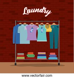 brick wall background of clothes in hangers with towels down