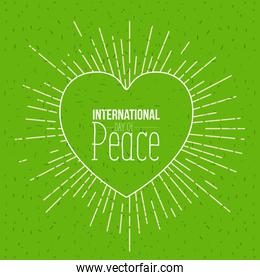 color background with silhouette heart symbol and text international day of peace with linear brightness