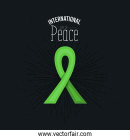 color background green lace bow symbol with text of international day of peace