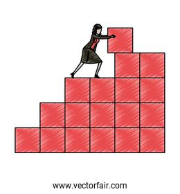 businesswoman pushing a block in structure of bricks in pencils colored silhouette