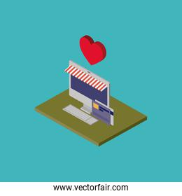 desktop computer and credit cards and heart on top over green floor colorful background