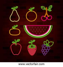 fruits set in neon sign on brick wall