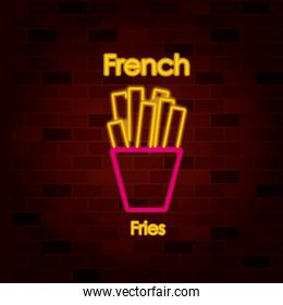 french fries on neon sign on brick wall