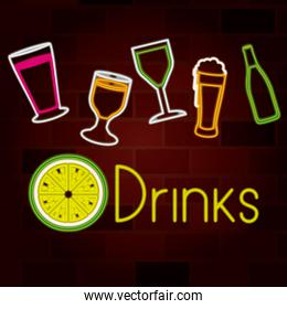 glass drinks set on neon sign on brick wall