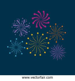 fireworks bursting in glowing multi colours on dark blue background