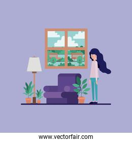 woman in the living room with houseplants and lamp