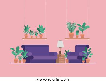 living room with houseplants and lamp